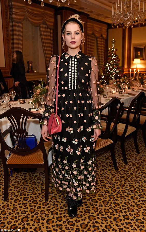 Chic:: Lucy Boynton also made a stylish appearance at the bash, in an equally flowery black maxi dress and preppy patent loafers