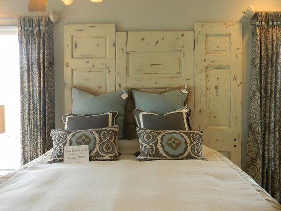 Headboard made with old doors.