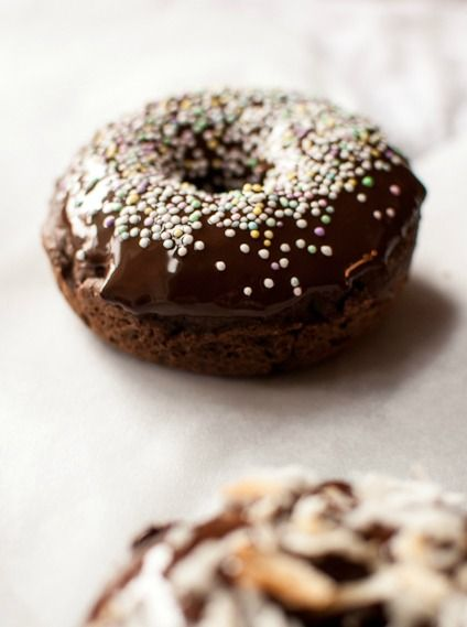 Baked Chocolate Donuts | Donuts have never tasted so delicious! Click here to get the full, decadent recipe for these quick and easy sprinkled donuts. They will surely satisfy your sweet tooth any time of day!