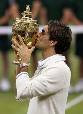 Roger Federer with his seventh Wimbledon trophy.