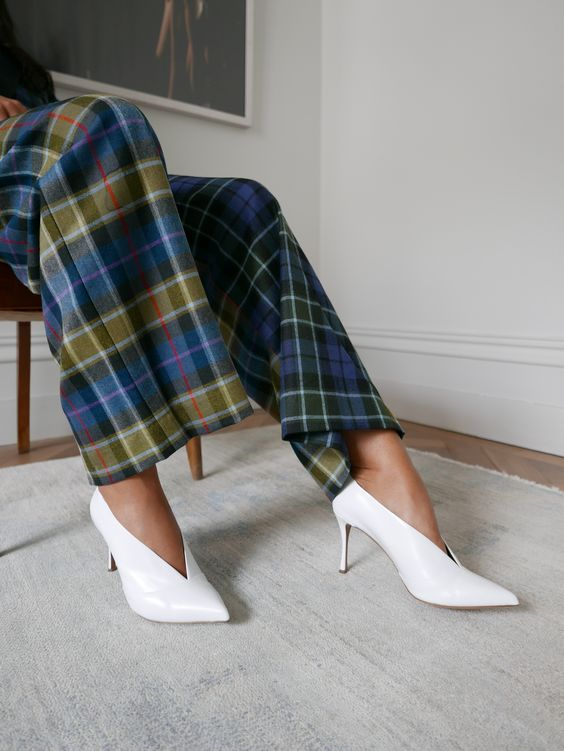 White accessories have the ability to take any outfit to the next level, which is why they aren't going anywhere this season. Tabitha Simmons' 'Strike' pumps are made from smooth leather and defined by their leg-lengthening low-cut vamp. They look especially cool with light-washed jeans.