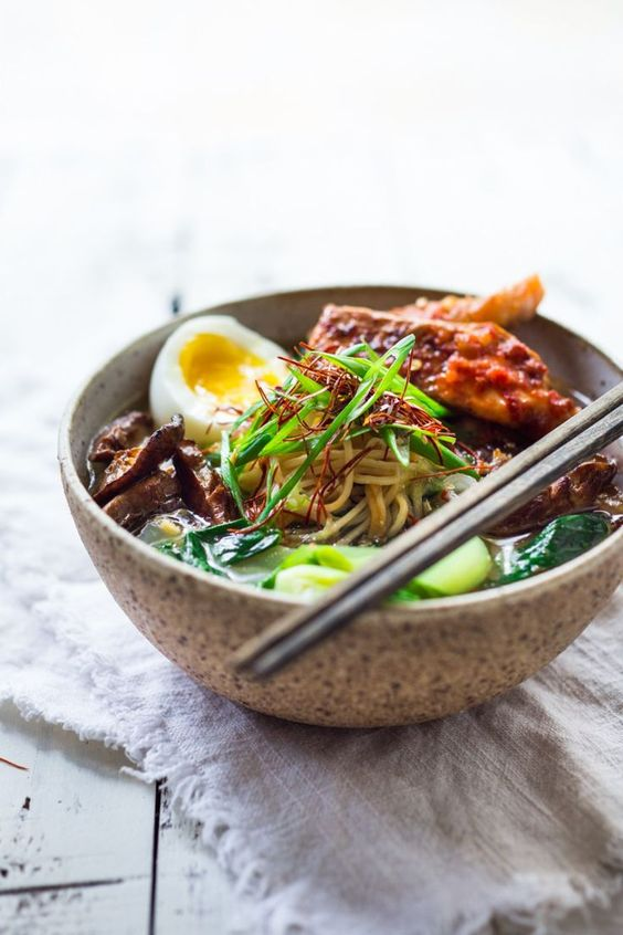 Simple Spicy Miso Ramen w/ Roasted Chili Salmon ( or tofu!) with bok choy, mushrooms and scallions. Vegan and Paleo adaptable! Swap out zucchini noodles or kelp noodles to keep it Paleo! Make in 30 minutes! | www.feastingathome.com