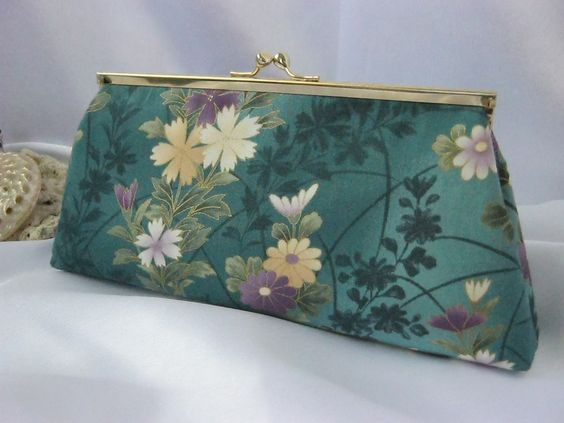 Teal background with flowers - clutch