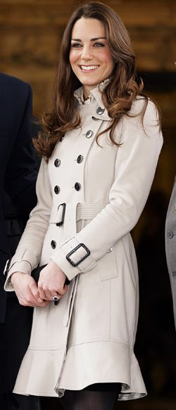 Kate Middleton in a double-breasted khaki trench coat by Burberry.