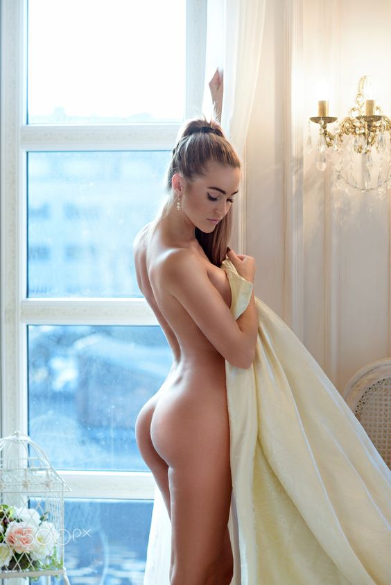 Beautiful nude sexy lady in elegant pose - Beautiful nude sexy lady in elegant pose. Portrait of fashion model girl indoors. Beauty blonde woman with attractive buttocks. Close-up female ass and naked body