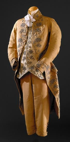 3-peace suit, probably Spain, c. 1780. Curry silk with floral metallic thread embroidery; waistcoat: cream silk with similar embroidery.