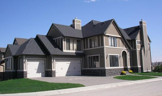 House Chimney Design tudor inspired roof lines, strong built-out full height fireplace