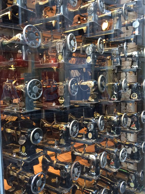 Old sewing machines fill every window of retailer All Saints, Buchanan Street, Glasgow