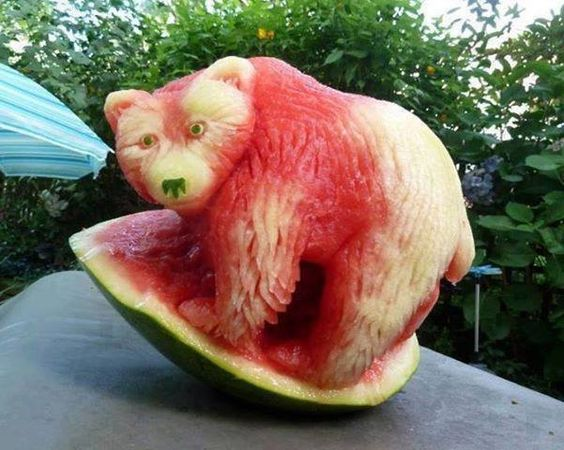 Bear carved out of a watermelon .