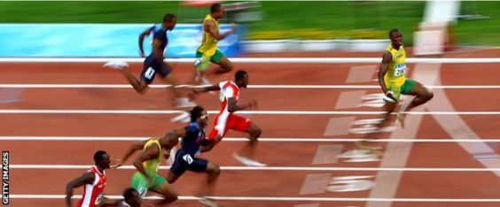 First act of the 'triple triple': Bolt powers to victory in the 100m final at the 2008 Beijing Olympics in a world-record time of 9.69 seconds