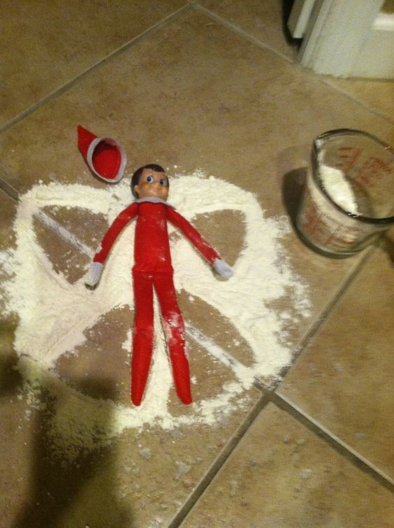 Elf making a snow angel (made out if flour)