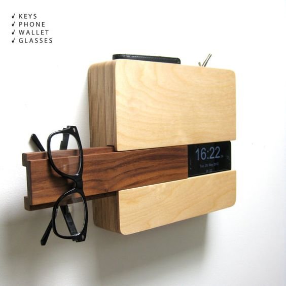 The Butler is made to fit your wallet and keys in the top sleeve, your iphone on the side slot with a concealed space for your charging cord, and glasses/hat/scarf or whatever other go-to item on the slide out walnut piece.