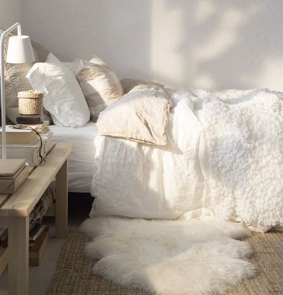 A fuzzy rug right next to your bed will make it so much easier to actually get up. | 19 Ridiculously Cozy Ways To Take Your Bed To The Next Level