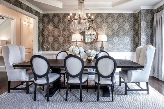 Elegant dining table features an octagon tray ceiling accented with a clear beaded chandelier ...: