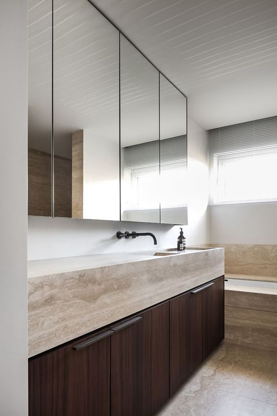 Love the minimalist lines of this wall hung stone bathroom sink vanity