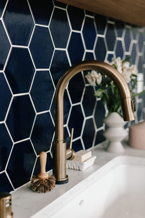 We're sharing some of the dreamiest spaces that have incorporated navy tile in backsplashes of kitchens, bathrooms and even laundry spaces. See the possibilities!