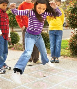"Math Hopscotch...Hopscotch square in the shape of a calculator.  The first player tosses her stone on the ""1"" key. She then hops on an equation equal to 1 (for example, she might jump to the following keys: =, 1, +, 0 or =, 3, -, 2). Players use 1-footed hops when landing on odd numbers and zeroes, and 2-footed hops for even numbers and symbols. A player's turn continues until she makes a mistake, such as stepping on a line or hopping on an incorrect equation. The winner is the first person…"
