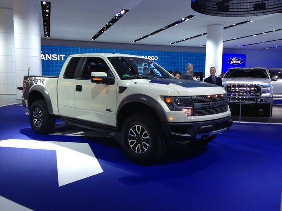 white Ford SVT offroad factory modified F-150 Raptor truck