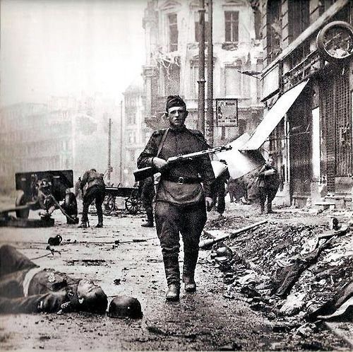 A Wehrmacht casualty (who appears to be the recipient of the Knight's Cross) of the Battle of Berlin. Notice that he is carrying a captured PPSh-41.