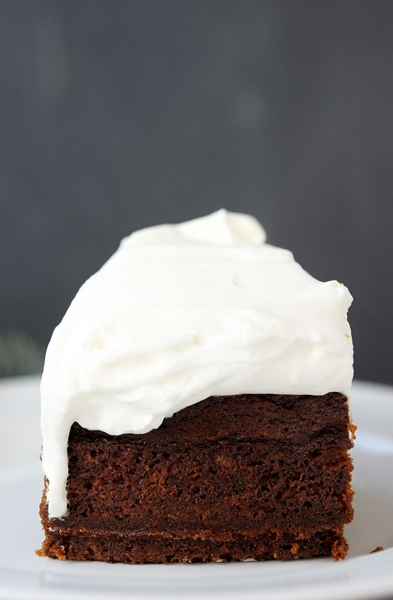 Family favorite gingerbread cake recipe with lemon whipped cream.