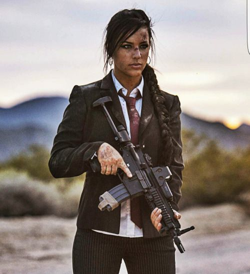 A lady, a suit and a whole lot of machine gun power