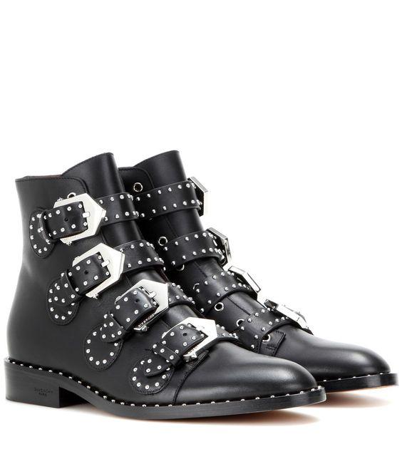 Givenchy - Bottines en cuir clouté - Givenchy présente des bottines aux accents baroques et gothiques. Confectionnées en cuir noir, elles se ferment à l'aide de quatre brides à boucles argentées. Ponctuées de mini clous métalliques, elles dessinent une démarche rebelle chic. seen @ www.mytheresa.com