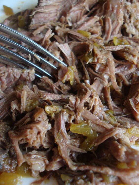 This crock pot shredded beef makes the BEST tacos and enchiladas!