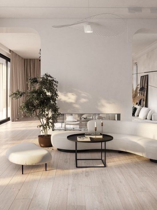 Elegant Minimalist Living Room With A Curved Sofa Living Room Designs Minimalist Living Room Living Design Elegant minimalist living room design