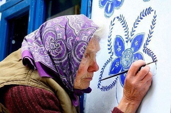"""Anežka Kašpárková will soon be in her 80s, but she can't imagine life without work. In the past she worked in agriculture, but currently she paints! This is the 30th year of her village painting project, including inside and outside its 18th-Century chapel and bell tower. She always uses Ultramarine Blue, as the colour """"looks very expensive and good quality"""". The decorations are designed from her imagination, many resembling blossoming flowers: """"I create what I think of,"""" the grandmother…"""