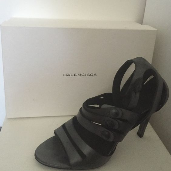 Balenciaga silver Pumps - 100% authentic Beautiful dark silver strappy, open toe heels from Balenciaga. Size 40. Worn 1 time. Too big for me :-( there is a strap that goes around the ankle as well. Comes with cloth bag for storage. I can send the box too for additional shipping costs. Balenciaga Shoes Heels