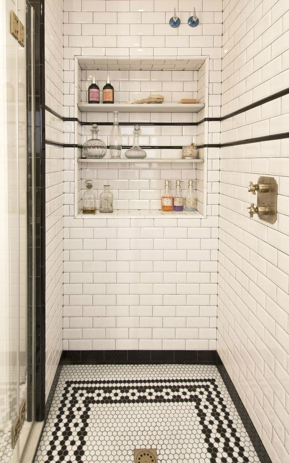 Love the black and white subway tiles, hexagonal tiles and custom recessed niche in this shower