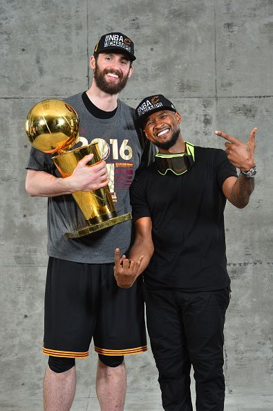 Recording artist Usher poses with Kevin Love for a portrait after NBA Championship against the Golden State Warriors during the 2016 NBA Finals Game...