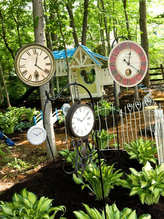 Clocks on shepherd's hooks. For my future Alice in Wonderland backyard. :):