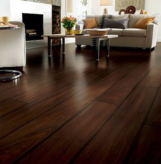 Interior design the awesome flooring of your home nice for Dark brown laminate wood flooring
