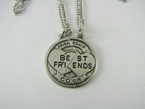 """Here is unique gift for you and your best friend! This very special Friendship Coin is factory engraved with interlocking hearts, and reads Best Friends, Friendship Coin when the two pieces are together. The coin is about the size of a quarter. The back side is blank - ready for me to engrave either your names or initials! Each piece comes on an 18"""" cable chain with a spring ring clasp. This set is a great idea for you and your best friend or other special someone."""
