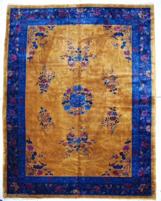 "This circa 1910 Mandarin Art Deco Chinese rug measures 9'11"" by 12'10"".  It has a yellow gold field with a center medallion containing a bird surrounded by flowers, all in shades  ..."