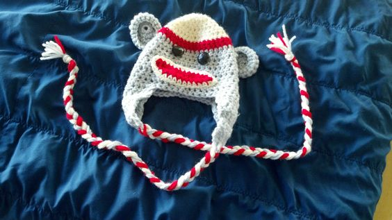 A fun and whimsical sock monkey hat just perfect for your baby or toddler!  It can be purchased at https://www.etsy.com/listing/204418430/crocheted-sock-monkey-hat-for-baby?ref=shop_home_active_13
