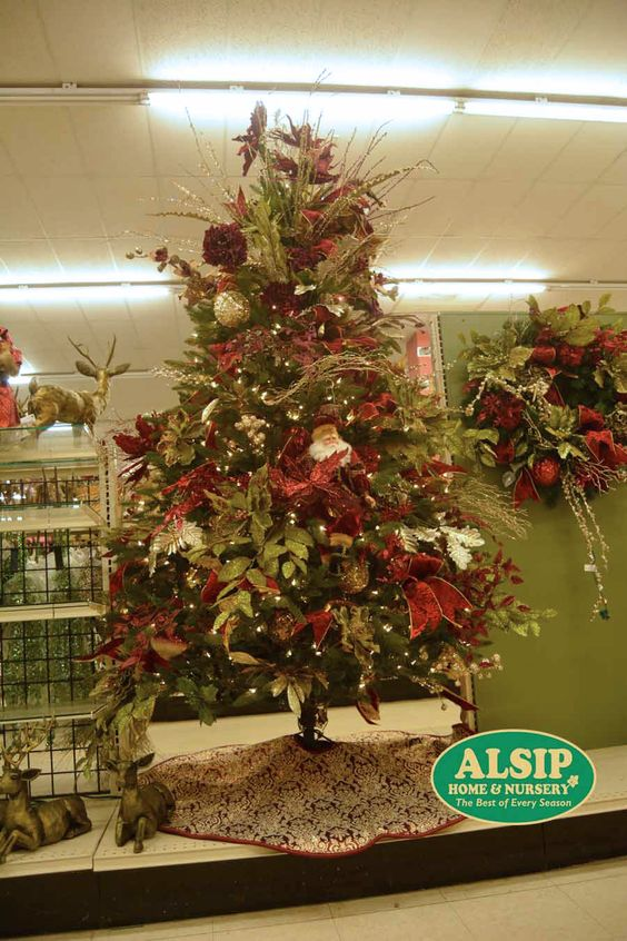 "Our ""Margaret"" tree is Rich and Regal with it's maroon and gold color scheme and very fancy fixins'."
