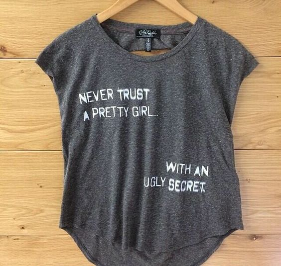 """""""Never trust a pretty girl... With an ugly secret."""" Pretty Little Liars t-shirt found at Aéropostale."""
