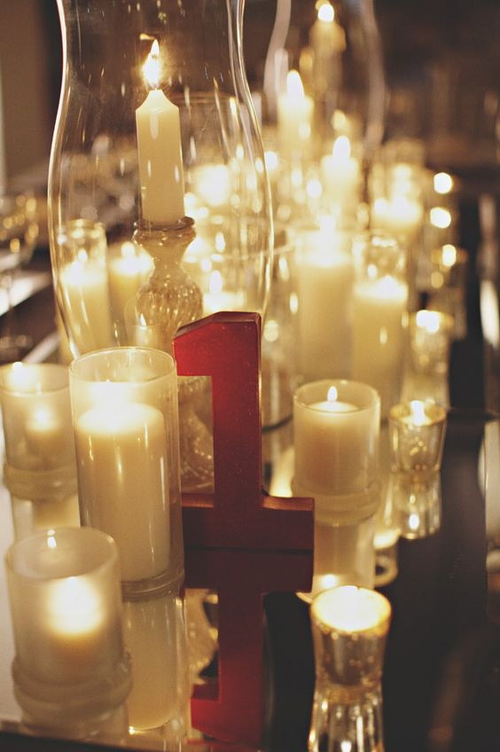 Flowerless wedding reception centerpiece all candles red for Glitter numbers for centerpieces