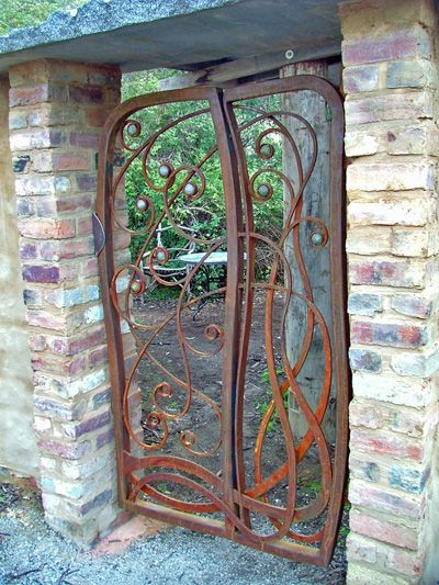 I would like to see a thicket flank this gate and have it go into a secret garden.