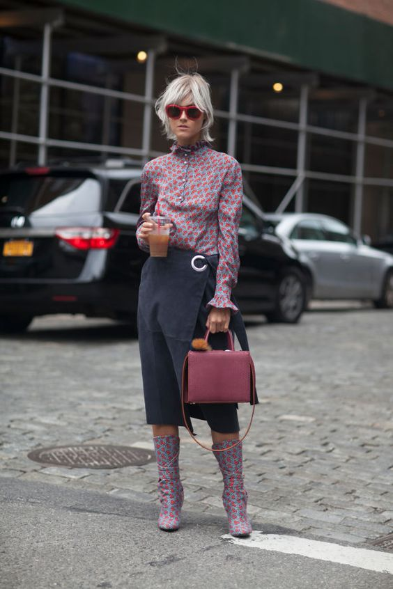Linda Tol of I Believe In Pink gets funky at NYFW in Tibi's Suede Wrap Skirt seen on Fashionista.