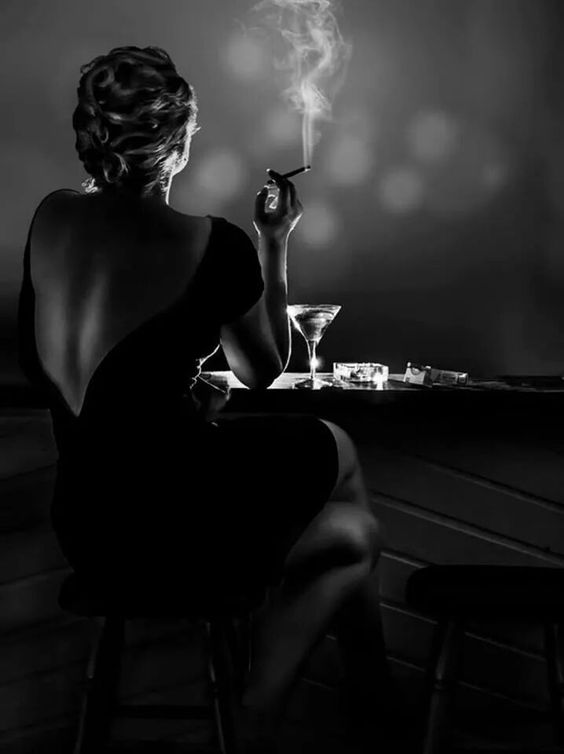 Femme Fatale Smoking, black and white photo. Not all have to be in the enhanced colours, yet it gives the sense of authority