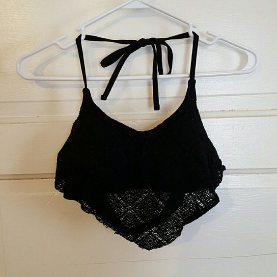 Swim halter top Black halter swimsuit top from target. Flowy mesh material on top of a padded top with removable cups. Ties around the neck and clasps in back. *lightly worn Xhilaration Swim Bikinis