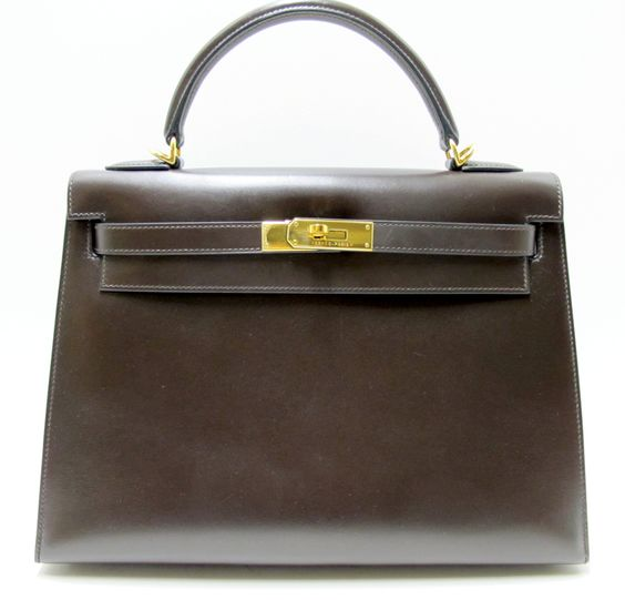 Hermes Kelly Sellier 32cm in Marron Fonce Box Leather Gold Hardware | Leather: Box leather | Hardware: Gold hardware | Blindstamp: K in square. | What's included: Clochette, Dust bag, Lock and keys and shoulder strap.
