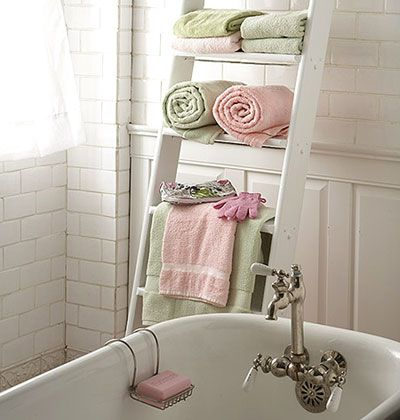 Towel Decor Ideas all crafts 11 Beautiful Ways to Display Bathroom Towels 6. Use a Ladder ~ Instead of installing a typical metal rack to hold your towels, enlist a ladder made of bamboo (or some other wood that can withstand humidity) to do the job. No tools required.