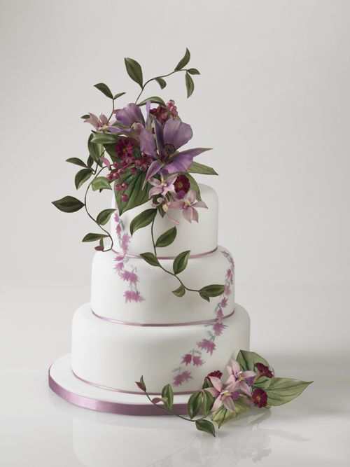 Gorgeous three tier cake with purple flowers - absolutely gorgeous.