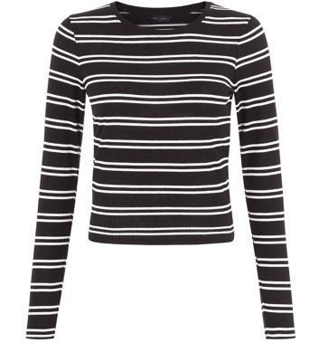 """This stripe ribbed long sleeve top is perfect of an autumn daytime wardrobe - try wearing with a black leather-look skirt and peeptoe block heel ankle boots to complement.- Double stripe print design- Rounded neckline- Simple long sleeves- Ribbed texture- Simple long sleeves- Model is 5'8""""/176cm and wears UK 10/EU 38/US 6"""