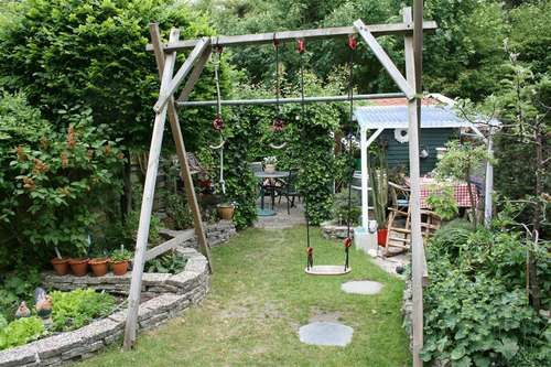 Homemade swing set this yard is amazing garden and for Diy adult swing set