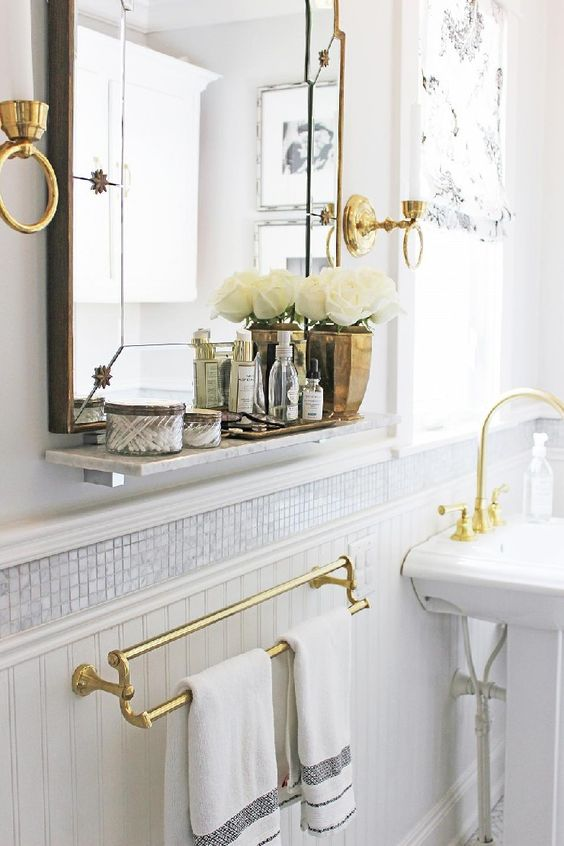 Classic, contemporary bathroom with brass hardware by Sarah Richardson in a Victorian style home. #bathroom #classic #brass #hardware